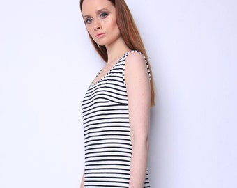Dress - Fashionable striped pattern with eye-catching silky details makes this dress a must-have in you spring/summer closet