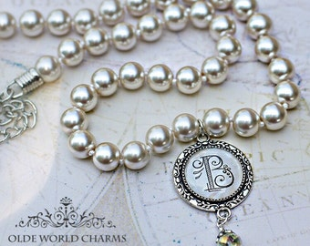 Pearl necklace with glass initial pendant.