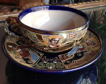 a cup and saucer in satsuma earthenware