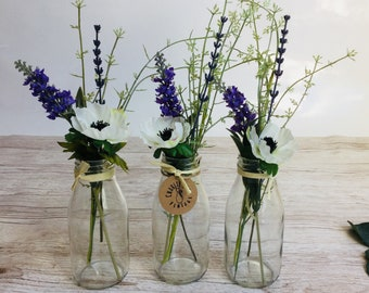 Set of three mini milk bottles with rustic flowers, twine and tag