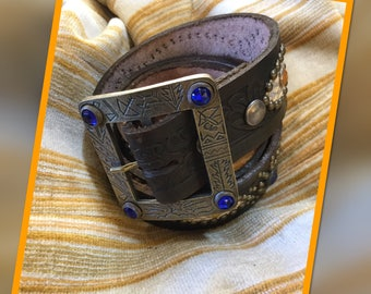 Classic vintage brown embossed leather and snake skin silver tone studded rockabilly western biker belt with limited edition buckle