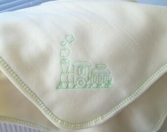 Fleece blanket with neon green train