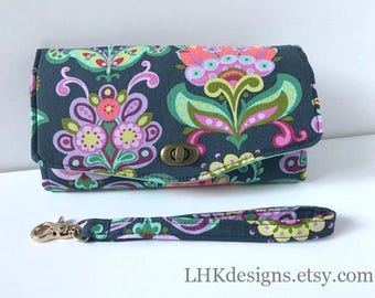Necessary Clutch Wallet in colorful floral with aqua lining and removable wrist strap