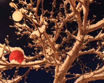Snowy Christmas Ornaments at Night