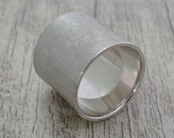 Wide (20mm) from 925 Silver ring. Band ring