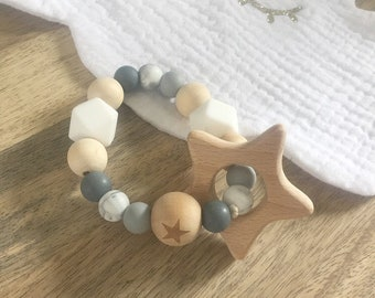 Natuel untreated wood and non toxic BPA free silicone star teething ring or bracelet.