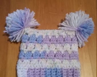 Adorable sack hat with pom-poms