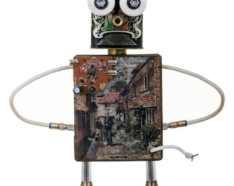 Found object robot named Grumpel. Creation No.2 of the TinFolk family