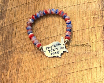 Freedom Isnt Free Bracelet helps provide service dogs to Military Veterans soldiers USA United States America red white blue American flag