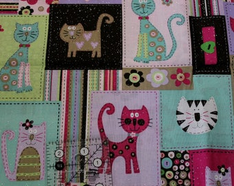 """Kitty flower blocks with sparkle  42""""-44"""" wide 100% cotton fabric"""