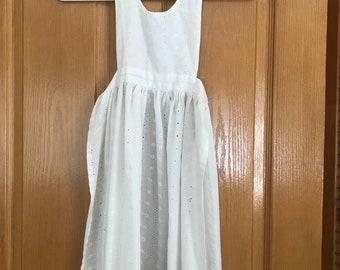 White eyelet child's apron