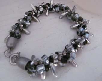 Elegant black, grey and silver kumihimo woven bracelet, with grey petals, price reduced for the holidays!