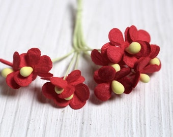 red paper craft flowers