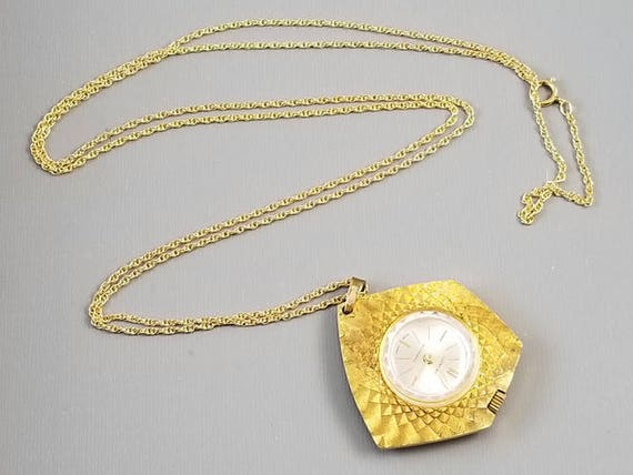 Vintage mid century Lucerno Antimagnetic Swiss Made ladies pendant necklace watch textured asymmetrical