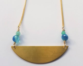 Half moon brass necklace with blue and teal accent beads