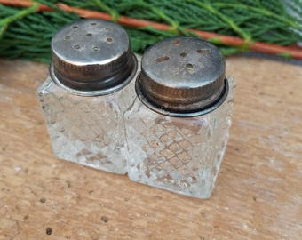Small glass salt and pepper shakers
