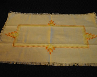 Embroidered napkin or dish towel with yellow and orange design -Sticker says Cottage Industry Program Korea