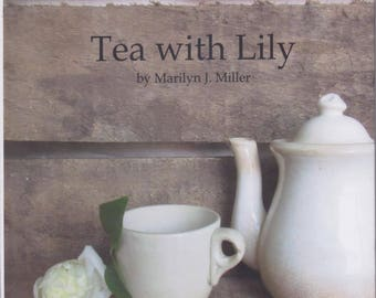 Tea with Lily is a 42 page hard cover book full of color photographs and tips on creating tea parties for children based on a theme.