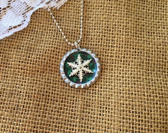 Green and white snowflake bottlecap necklace