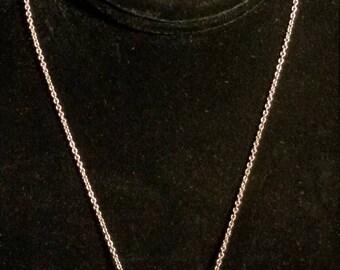 Simple, yet pretty.  Silver tone chain with aqua blue aurora borealis bead.