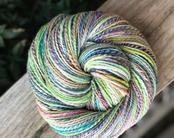 Handspun yarn, bright colors, yellow, purple, turquoise blue, pink and pale green tones, merino wool, three ply, DK sport weight, bright ton