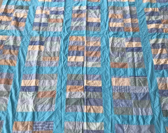 Vintage quilt top in shades of blue