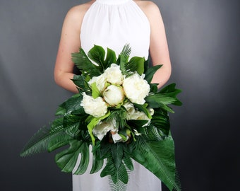 Tropical wedding bouquet with white flowers and greenery realistic silk peonies roses monstera leaves modern wedding bridal flowers ivory