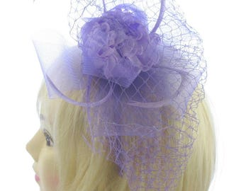 Lilac fascinator on a headband ,net flower and feather, Ladies Day ,Weddings,Bridesmaids,Ascot