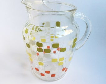 Green, Yellow, White and Red rounded corner square pitcher