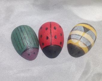 Trio of wooden bugs, beetle, lady bug, bee