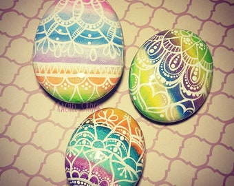 Set of 3 Easter egg painted stones.