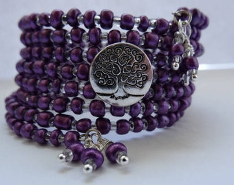 Multi layered magenta glass beaded memory wire tree of life button bracelet......8 layers!!!!