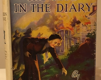 Nancy Drew - The Clue in the Diary by Carolyn Keene in White Spine Dust Jacket (C)