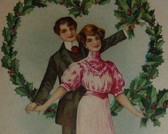 Well-Dressed Man and Woman in Heart of Holly Antique Christmas Postcard