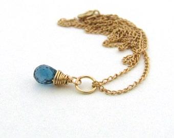 Tiny london blue topaz necklace, December birthstone, small london blue topaz pendant, gold wire wrapped necklace, blue stone necklace