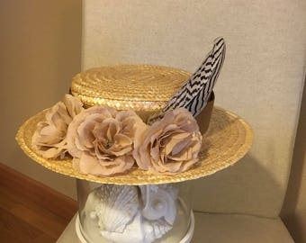 Canotier with pink flowers and black and white feather