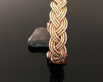 Magnetic bracelet in copper and brass, twisted, braided, with all its benefits