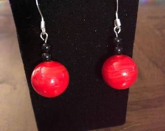 Round red and black glass earrings