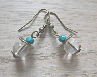 Earrings composed of two 8 mm diameter transparent round glass beads