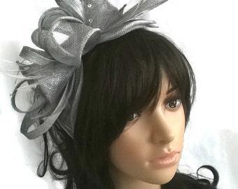 Silver Grey metallic Feather Fascinator..stunning  rosette fascinator on a headband