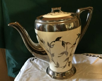 Vintage old silver luster coffee pot