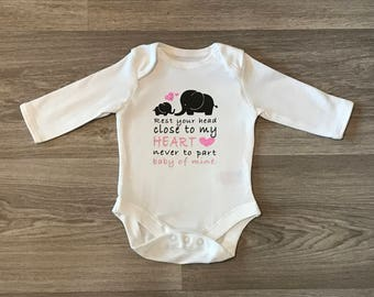 Baby vests, song words and elephants, pink or blue