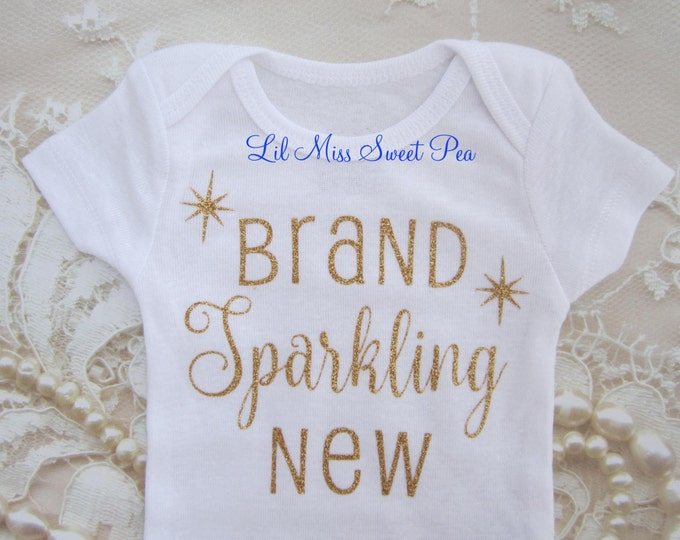 Welcome New Baby in Gold Glitter on White Outfit, Buy ONE for your favorite newborn, baby shower gift, by Lil Miss Sweet Pea