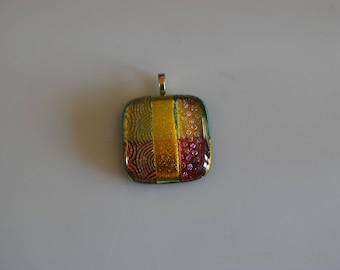 Golden Glow Fused Dichroic Glass Pendant With Purple Red and Green On An Adjustable Necklace