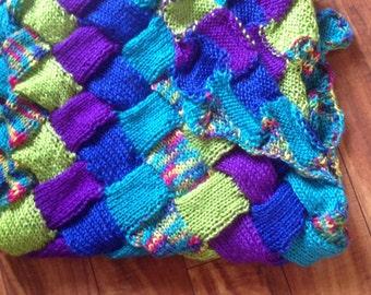 Hand-made knit blanket in lattice pattern