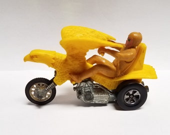 1972 Vintage  Hot Wheels Redline Era , RRRUMBLERS Bold Eagle Motor cycle toy, All original, Yellow Bike,  Tan Rider with Green sunglasses