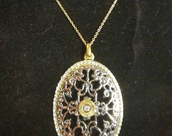 Necklace with recycled spent gun casing and crystal bling in the center. Bullet art