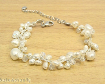 White freshwater pearl bracelet with crystal on silk thread