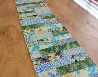 Green and blue quilted fabric reversible table runner