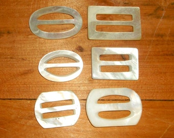 6 small Off- White MOP Buckles